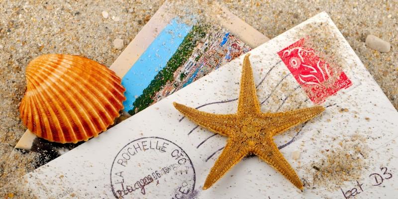 Postkarte im Sand